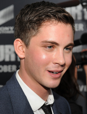 """Actor Xavier Samuel, who plays the part of """"Lieutenant Parker"""", gives interviews with the media on the """"Red Carpet"""" during the world premiere of the movie Fury at the Newseum in Washington D.C. (Department of Defense photo by Marvin Lynchard)"""